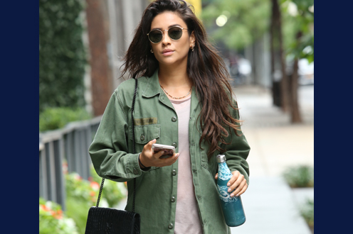 Shay Mitchell with Aladdin Bottle